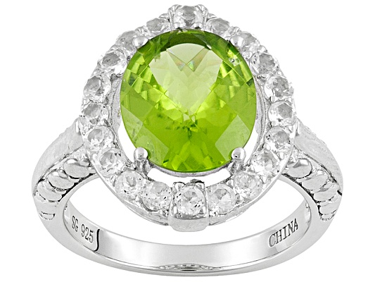 Qinpei Peridot (Tm) 3.80ct Oval With .66ctw Round White Topaz Sterling Silver Ring