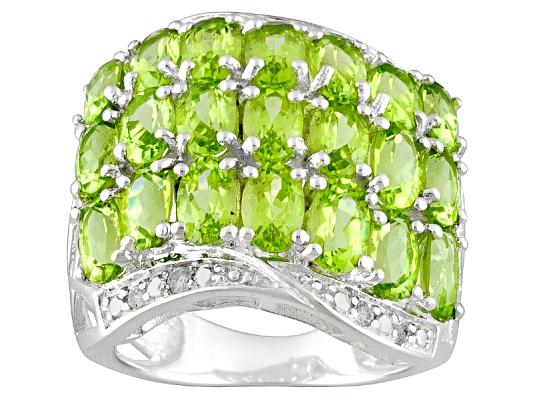 Manchurian Peridot (Tm) 5.46ctw Oval With .16ctw Round White Topaz Sterling Silver Ring