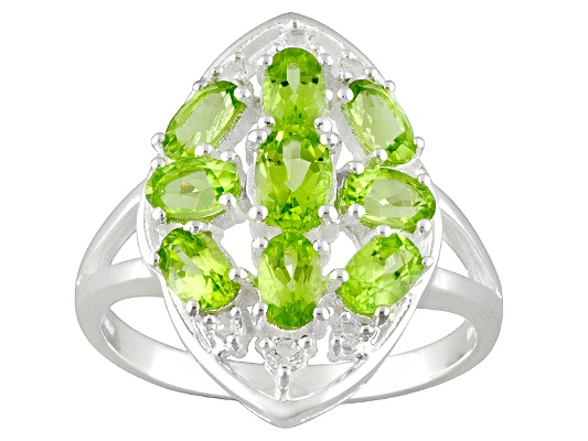 Manchurian Peridot (Tm) 2.60ctw Oval With .18ctw Round White Topaz Sterling Silver Ring