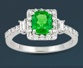 green gemstone and diamond ring
