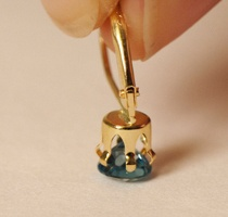 Gently push the setting down over your gemstone.