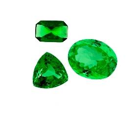 group of three green gemstones