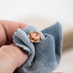 Cleaning cloth with morganite earring