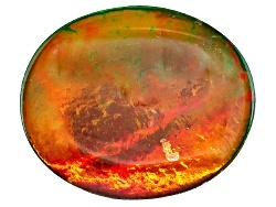 red orange and green gemstone