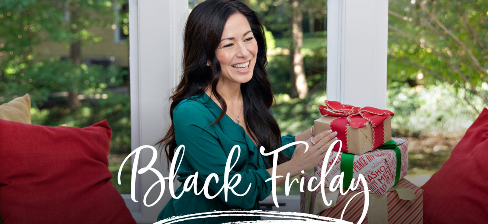 Black Friday: Woman wearing jewelry holding Christmas presents
