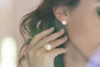 Woman wearing Bella Luce earrings and ring