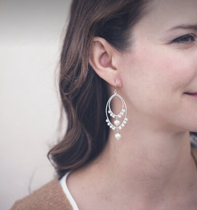 Woman wearing holiday pearl jewelry