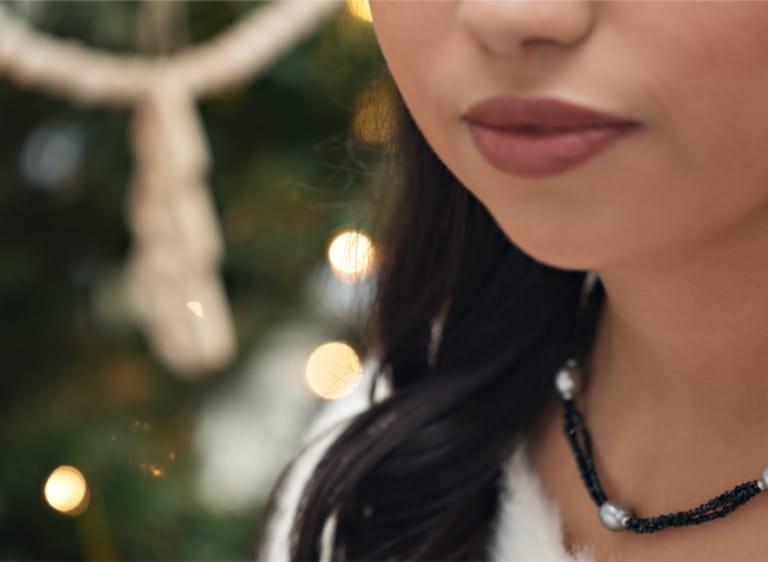 Woman wearing holiday jewelry