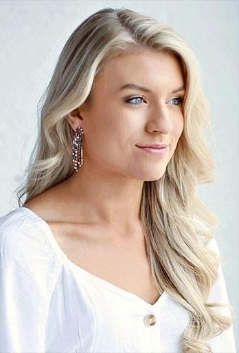 Woman wearing dangle earrings