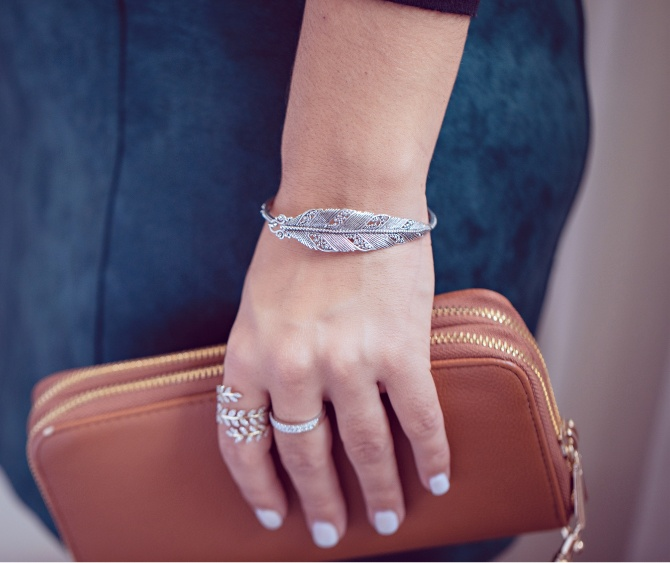 Woman wearing a leaf bracelet and ring