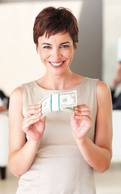Woman holding cash
