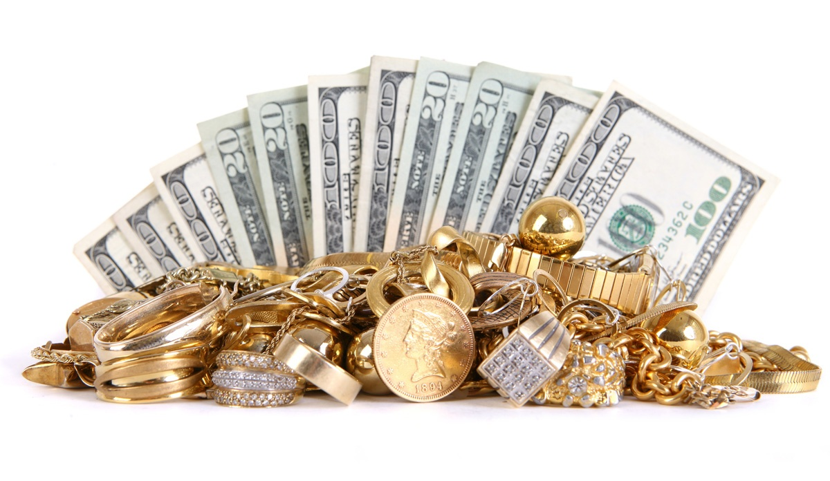 Pile of assorted gold items with cash