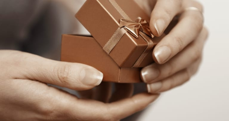 Woman holding a gift box