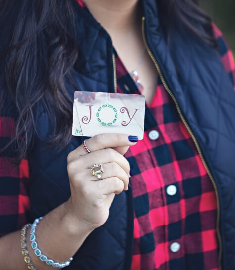 Woman holding a JTV Gift Card