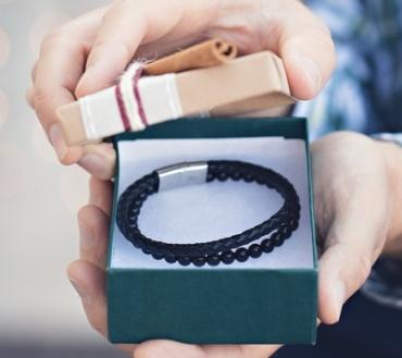 Men opening a bracelet