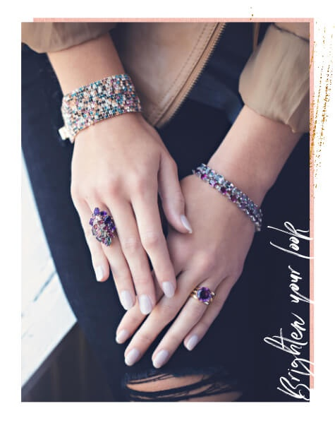 Woman wearing colorful gemstone rings and bracelets