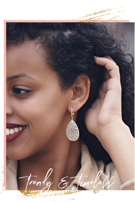 Woman wearing gold earrings