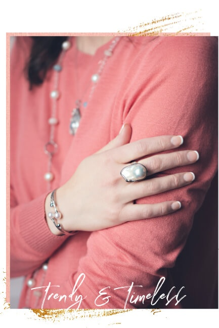 Woman wearing white gemstone jewelry