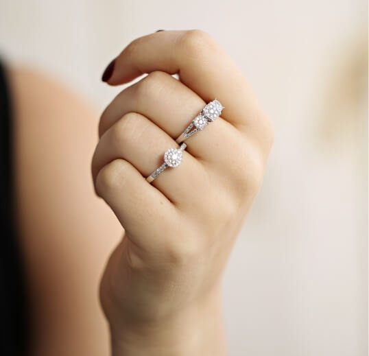 Woman wearing lab-grown diamond rings