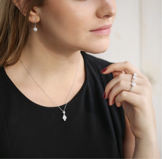 Woman wearing lab-grown diamond jewelry