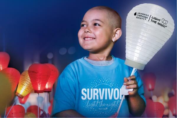 Child holding a lantern