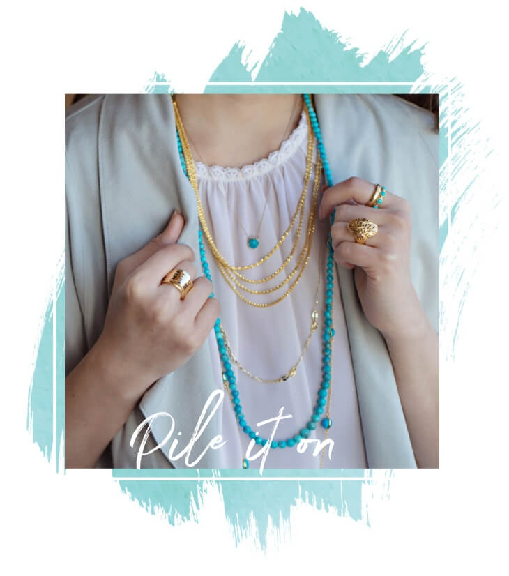 Pile it on - Woman wearing layered necklaces