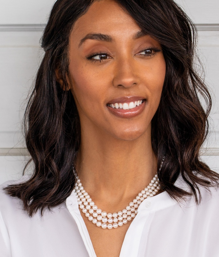 Woman wearing strand necklaces