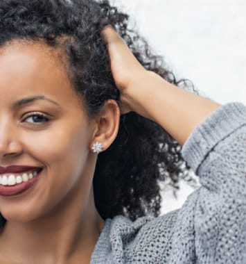 Woman wearing stud earrings