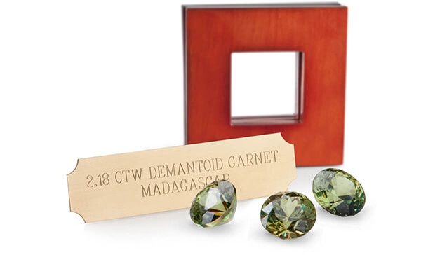 Three Demantoid Garnets with Case