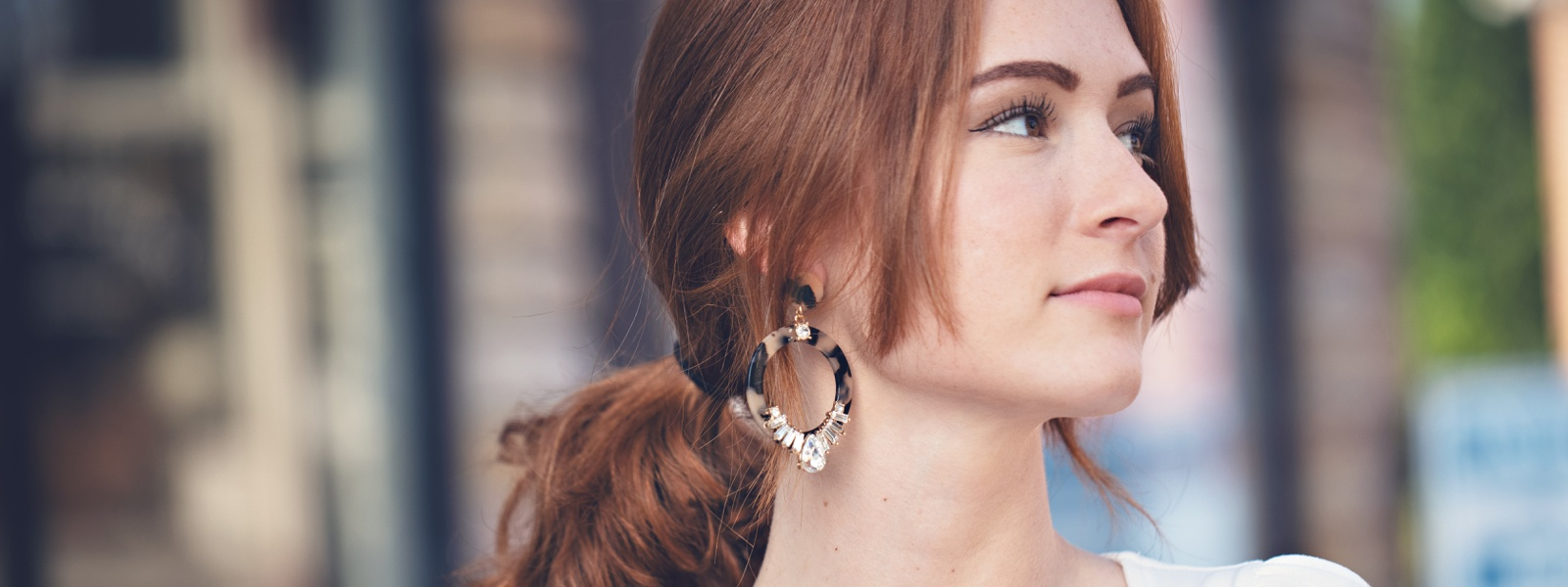 Woman wearing Off Park earrings