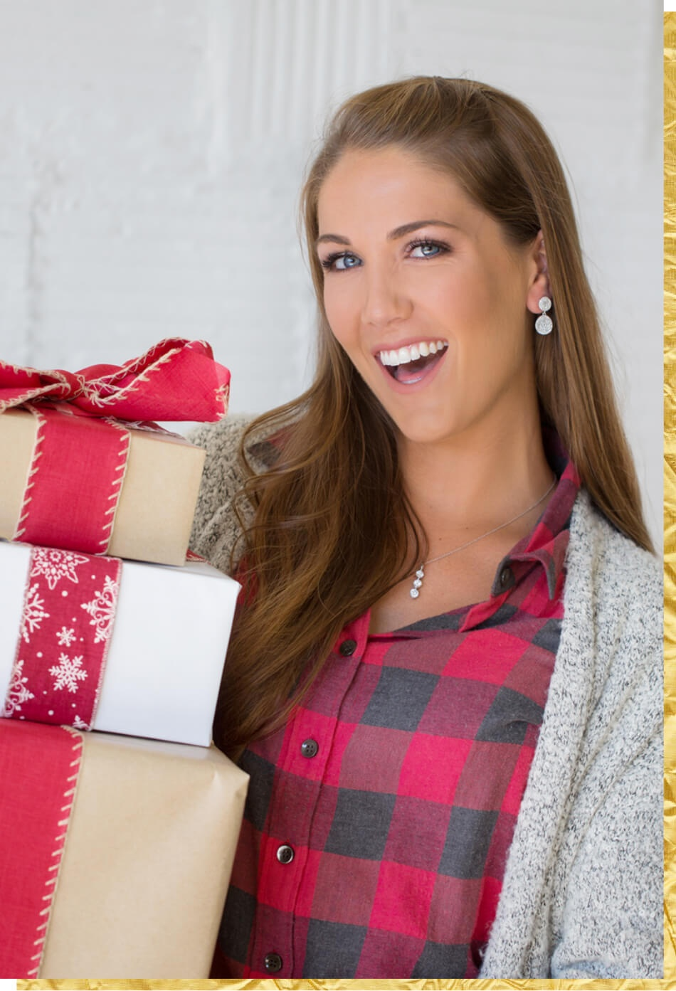 Woman wearing earrings and necklace holding holiday gifts
